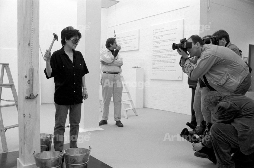 Yoko Ono, installing 'In Facing' exhibition at Riverside Studios, 1990