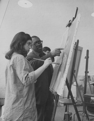 Jacob Lawrence with a student at Brandeis University, 1965
