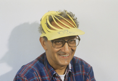 Frank Stella in an expandable foam rubber hat from Rio