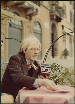Andy Warhol with Polaroid camera, c. 1972