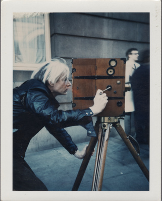 Andy Warhol with vintage 1907 camera, 1971