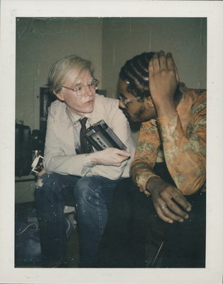 Andy Warhol and Stevie Wonder backstage at Rolling Stones co...