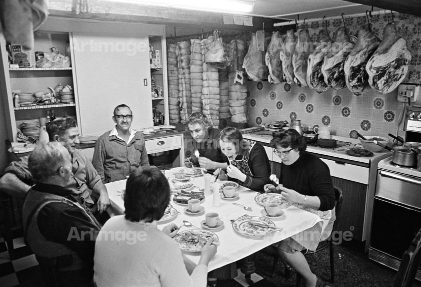 Pig killing: Cyril Richardson and family, lunch following the slaughter, Little Stainton, N.Yorkshire, 1976