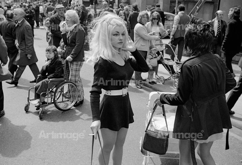 Enlarged version of North of England: Bystanders viewing carnival procession, Manchester, 1973