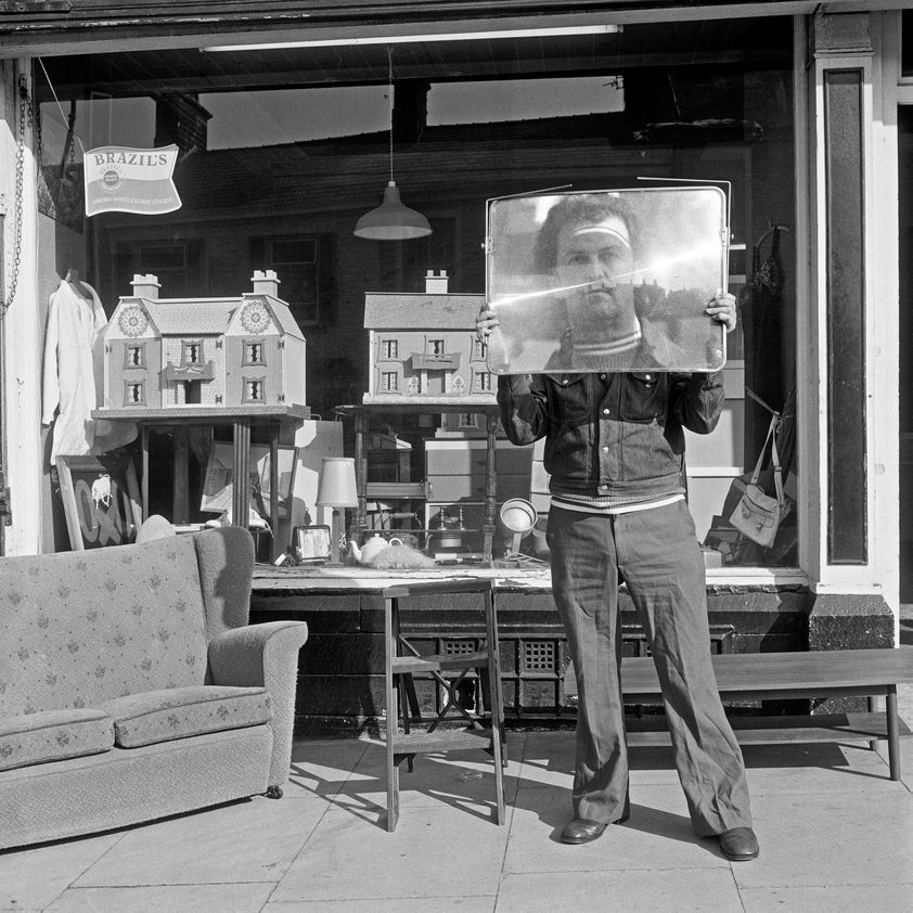 North of England: Second-hand goods shop with proprietor, Colne, Lancashire, 1975