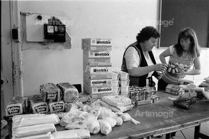 "alt=""Miners' wives and members of womens support groups make up food parcels for striking miners families, Rotherham, 30 April 1984"""