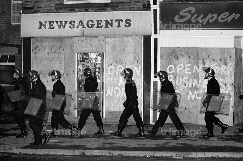 Enlarged version of Police in riot gear patrol Grimethorpe during the miners strike, 16 November 1984