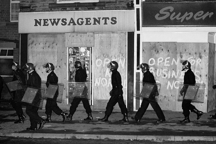Police in riot gear patrol Grimethorpe during the miners strike, 16 November 1984