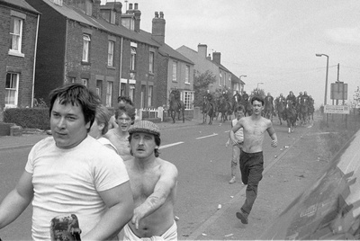Striking miners being chased by mounted police at Orgreave, ...