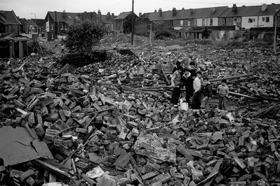 Children playing in the rubble of demolished houses, Darnall...