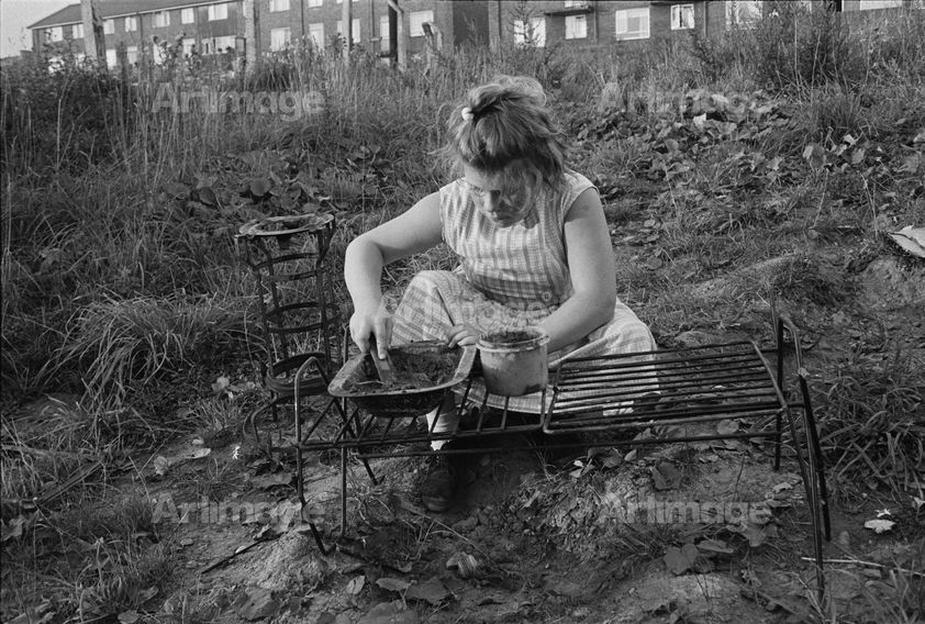 Girl playing, Byker, 1971