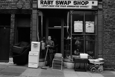 Isaac in front of his Raby Swap Shop, Byker, 1974