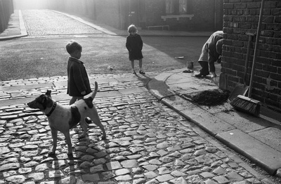 Children watching pavement repair, Byker, 1969