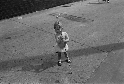 Toddler with a jazzband baton, Byker, 1975