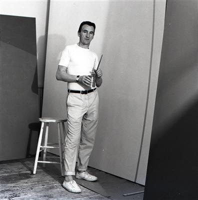 William Turnbull with Abstract Painting in his Studio, 1960s