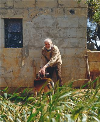 Victor Pasmore with his dog Zulu at the farmhouse in Malta, ...